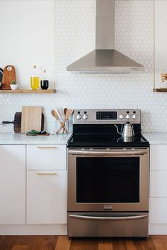 I like how tile backsplash stops under open shelf, thn goes up along hood..How to Approach a Kitchen Remodel