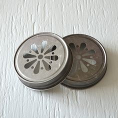 Hey, I found this really awesome Etsy listing at http://www.etsy.com/listing/150599332/25-pewter-daisy-cut-mason-jar-lids