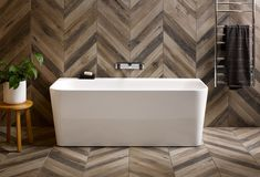 Playing with patterns on the floor and walls adds originality by breaking the linear shapes in the bathroom.
