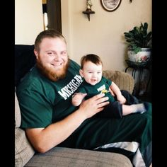 a little nephew/uncle time before work! we're sporting our college teams today :) him with #coloradostate #rams and me with #michiganstate #spartans #collegefootball #nephew #gingerbeard #ging #ginger #blueeyes #Padgram