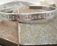 A Body in Motion Stays in Motion Custom Quote Bracelet, aluminum cuff, exercise, fitness, plus size available. $15.95, via Etsy.