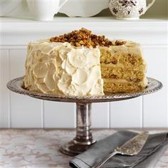 Maple Walnut Cake Recipe -This maple-flavored cake with candied walnuts honors my grandpa, who made maple syrup. —Lori Fee, Middlesex, New York