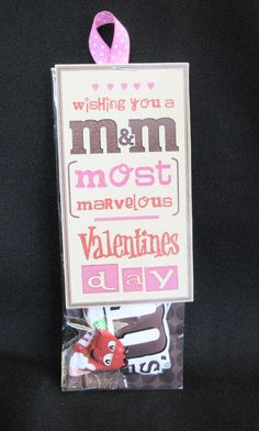 "Valentine - Most Marvelous    A cute little bag that could be given to most anybody (a sweetheart of not)!  A regular bag of M&M's in a fitted clear cellophane bag, with a cute kraft tag that reads, ""Wishing you a Most Marvelous Valentines Day"""