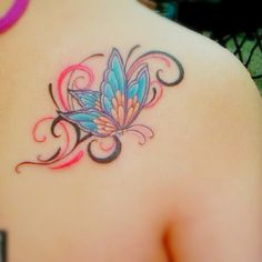 A colorful butterfly tattoo on the shoulder