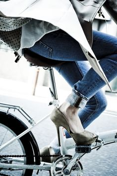 denim and pumps on a bicycle