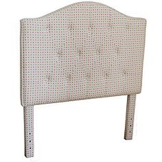 This adorable headboard features pink and green polka dot fabric in a beautifully constructed tufted style.