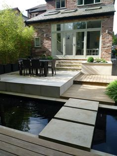 contemporary garden for a Victorian semi detached house, using contemporary sawn sandstone paving and timber decking for the changes in level. Large stone steps are built across the reflective pool running across the entire width of the garden. Deck Steps, Garden Steps, Back Garden Design, Patio Design, Modern Pond, Sandstone Paving, Contemporary Garden Design, Timber Deck, Landscape Plans