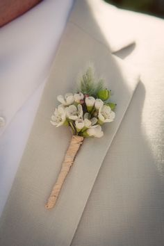 the wildflower look - wax flower boutonniere - wedding flowers - white pinned by http://whimsicalfloral.com