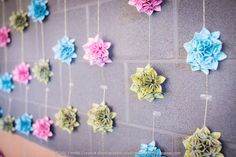 """DIY kusudama garland backdrop - patterned paper from Michaels, handcut to 3""""x3"""" squares & folded into individual petals, then glued together into demi-flower balls and glued onto shiny gold thread and strung from removeable 3M clear hooks  (c) mINK Creative photographic studios (photographer)"""