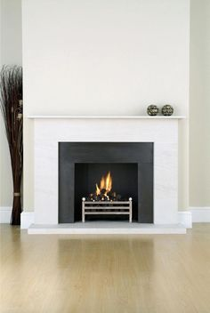 If you are looking to give your room a focal point or something to highlight it, look no further than the fireplace mantel that's already there. Many tend to leave their fireplace mantels bar… White Fireplace Surround, Slate Fireplace, Limestone Fireplace, Home Fireplace, Fireplace Remodel, Fireplace Inserts, Modern Fireplace, Living Room With Fireplace, Fireplace Surrounds