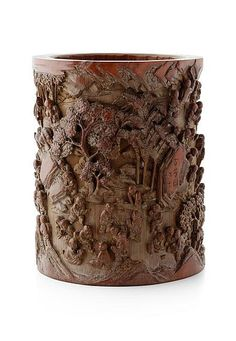 CARVED BAMBOO '100 BOYS' BRUSHPOT QING DYNASTY, 19TH CENTURY the cylindrical sides carved in high relief with the 100 boys engaged in various pursuits, signed 20cm high