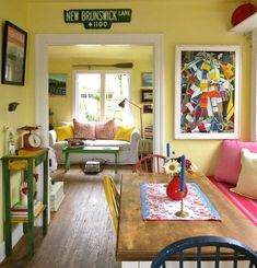 Small Beach House with yellow walls and red and blue accents: http://beachblissliving.com/cottage-in-red-blue-yellow/