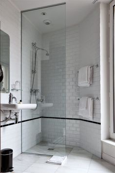 White subway tile with black trim in shower stall for European bathroom stalls
