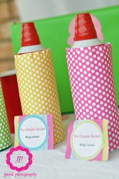 Love this!  Cover the whipped cream cans with fun paper!