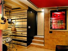 From Mix-and-Match Music Room to High-End Recording Studio: This high-end, professional recording studio is now ready to make music. Live edge pine wall slats, cork wall paneling and contemporary wall art revamp what were once plain, beige walls. Track lighting and rich, bold colors add an edgy and contemporary feel to this former basement. From DIYnetwork.com