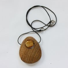A wooden pendant inlaid with a piece of honey amber. A bit of warmth and tenderness of nature. Jewelry, accessories from amber, wood with amber. Each hand crafted piece contains passion, imagination and creativity. Amber, Wood, Hand work For pricing and details please visit: www.artmenacrafts.com . Custom pieces available upon request.