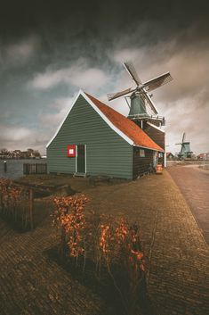 Windmills in Zaandam, Holland, Zaanse Schans neighbourhood Travel Around Europe, Holland, Red And White, The Neighbourhood, Layout, Cabin, House Styles, Windmills, Home Decor