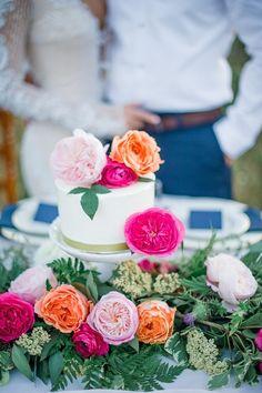 One Tier Wedding Cake Topped with Colorful Flowers!   Tonie Christine Photography on @heyweddinglady via @aislesociety