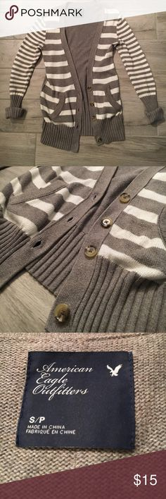 Striped cardigan with buttons Good used condition. A grayish-beige color (depending on what light you are in). It's very long, so great to wear with jeans and a camisole underneath. American Eagle Outfitters Sweaters Cardigans
