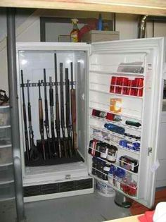Very interesting way to store your guns!  Build a shelf in that refrigerator and Rifle Rods would work perfectly!