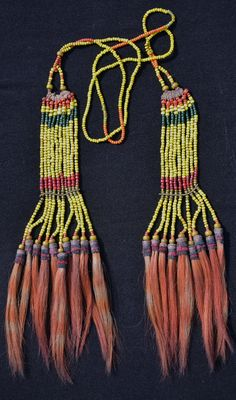 India ~ Nagaland | Warrior's ornament; glass beads, cane, dyed wild goat hair | Konyak Naga | 1st half of the 20th century | Sold