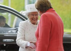 All smiles: The Queen beams as she shakes hands with Germany's Chancellor Angela Merkel in Berlin this morning