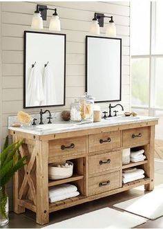 Beautiful rustic farmhouse wood bathroom vanity - love the shiplap and mirrors too!