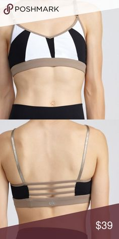 NWT Alo Yoga Trace 2 Bra New with tags Alo Yoga Trace 2 Bra. The colors are white, black, and gravel. The size is medium. The straps are adjustable. ALO Yoga Tops