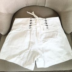 Bcbg maxazria white shorts Sz 2 linen/cotton Kind of height waist , pretty designer on waist , 2 front pocket and one small on back , 65% cotton 35% lined BCBGMaxAzria Shorts