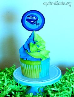Seattle Seahawks cupcakes! Half blue, half green on the inside and also swirled buttercream on top.
