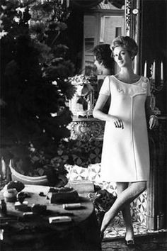 Marella Agnelli in her library in Turin from Vogue, Jan. 1, 1967.  Marella's dress is by Courreges. Photo by Henry Clarke.