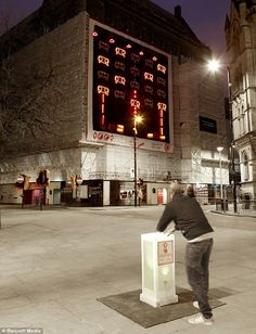 50ft tall interactive space invaders game created using road barriers on the town hall in Manchester. Interactive software written by Jnr Hacksaw enables passers by to press a button on a bollard and shoot the invaders.