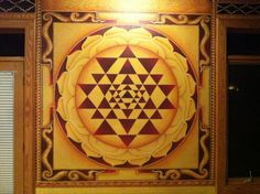"The Sri Yantra or Sri Chakra or Mahameru [3D] is a yantra formed by nine interlocking triangles that surround and radiate out from the central point, (bindu) the junction point between the physical universe and its unmanifest source. It represents the goddess in her form of Shri Lalita Or Tripura Sundari, ""the beauty of the three worlds (Heaven, Earth, Hell)""."