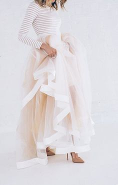 There is nothing that we love more than a bride who takes a non-traditional take on her bridal look. The blush ballgown skirt  looks great paired with a simple striped long sleeve shirt.