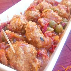 Spanish Meatballs Appetizer Recipe Appetizers with olive oil, red pepper, purple onion, garlic, crushed red pepper, wine, diced tomatoes, diced tomatoes, Manzanilla olives, ground chicken, purple onion, seasoned bread crumbs, large eggs, paprika, red wine vinegar, dried thyme, ground black pepper, salt