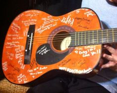 I bought a cheap guitar and had everyone at my husband's suprise bday party sign it.  Cool twist for a guest book.  :D