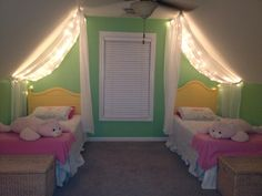 Canopy on slanted ceiling with lights. I think I'm definitely going to do this in my daughters room when we move!