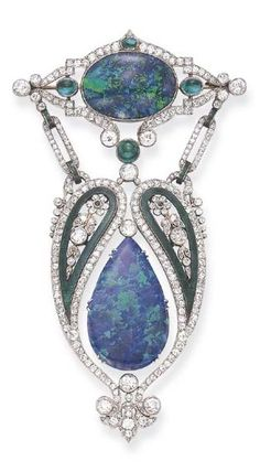 A BELLE ÉPOQUE GEM-SET AND ENAMEL BROOCH. Designed as an independently-set pear-shaped cabochon opal, within an openwork old European-cut diamond surround, enhanced by green enamel paisleys, each centring upon an old European-cut diamond and single-cut emerald foliate motif, from a navette-shaped old European-cut diamond plaque, centring upon an oval cabochon opal, accented by cabochon emeralds, mounted in platinum, circa 1915.