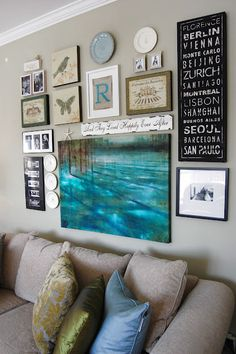 Create An Eclectic Gallery Wall!  Love the Turq picture in the centre.  Great website for picture display ideas