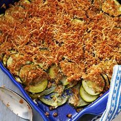 Zucchini Gratin Recipe      2 cloves garlic, minced     3 tablespoons extra-virgin olive oil, divided     1 teaspoon dried marjoram or thyme     1/4 teaspoon salt     1/4 teaspoon freshly ground pepper     3 medium zucchini, thinly sliced (1/8 inch)     1/2 cup coarse dry breadcrumbs (see Tip), preferably whole-wheat     1/2 cup grated Parmesan cheese