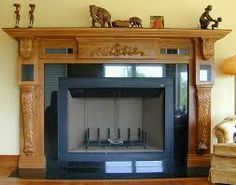 Hand carved wooden appliques and corbels make a house fireplace into a home feature