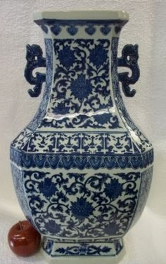 Blue and white Chinese Porcelain Vase with dragons handles.