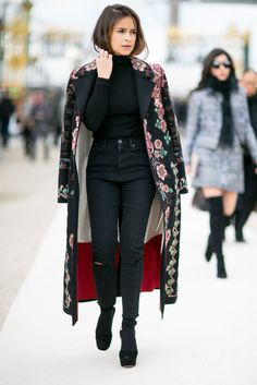 A printed coat can add vibrance to an outfit.