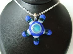 Glass pendant in blue with sterling silver by AndisJewelry on Etsy, $99.00