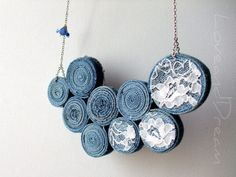 denim and lace necklaces  ~ wouldn't wear this probably as a necklace but like the idea of the coiled up denim for other things