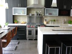 great kitchen except for the two frosted cabinet doors. Make them the dark wood or shelves