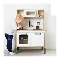 IKEA - DUKTIG, Play kitchen, , Encourages role play which helps children to develop social skills by imitating grown-ups and inventing their own roles.A dream come true for tiny master chefs and bakers. In this complete kitchen they can cook, just like the grown-up chefs on TV, and let the whole family taste their new creations.This toy kitchen has both a realistic faucet and a sink. There's battery-operated light diodes that shuts off automatically, and three fully opening cabinets with…