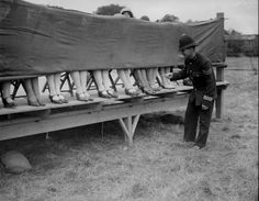 Peekaboo :: A policeman judges an ankle competition at Hounslow, London, 1930