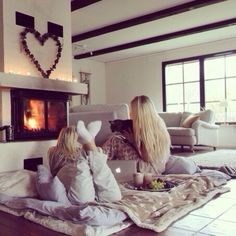 Ugh their lazy day looks beautiful! The cat, the fireplace, the warm blankets and the fuzzysocks!!