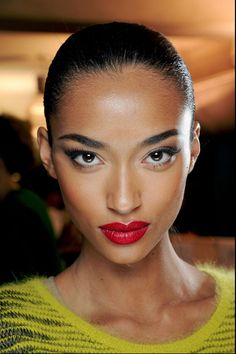 Slicked Hair Big Brows Red Lips « mariankihogo.com -- Love the look.  Very Sade!